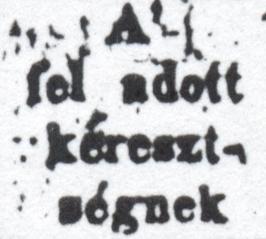 "A little square box that reads something like ""A' fel adott kéreszt- ségnek"""