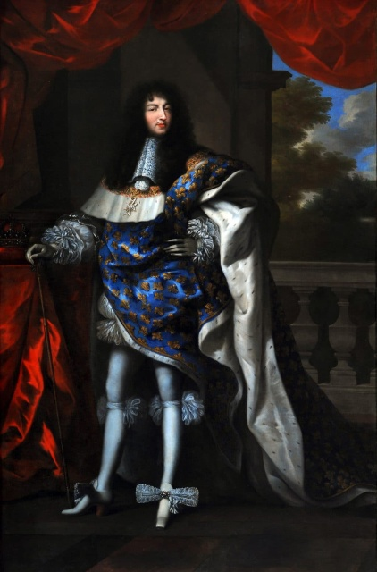 Louis, age 29.  He is wearing his coronation robes, including a heavy blue satin robe with gold fleurs-de-lis. But the robe is swept back to reveal his legs.  He puffy white pantaloons only come down to mid-thigh.  Below that he wears skin-tight white hose, with ruffled white garters at the knees, and square-toed white high-heel shoes with enormous bows.