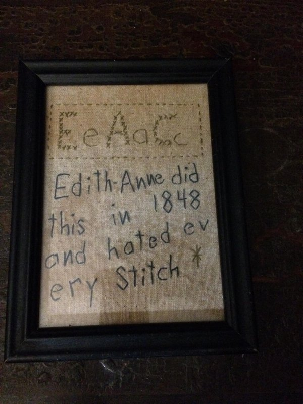 "Framed needlework proclaiming ""Edith-Anne did this in 1848 and hated ev ery Stitch"""