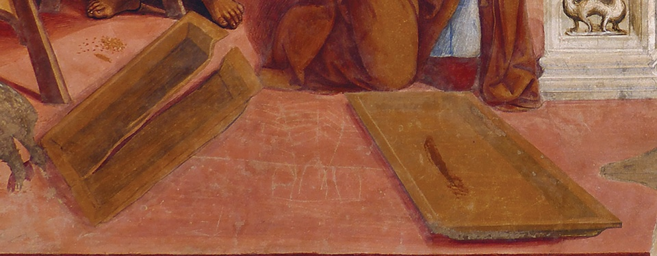 Detail of the painting, showing just the two piece of the broken colander, lying on the floor. Each piece is a medium brown color, perhaps made of wood.  The left piece has a large crack running lengthwise almost the whole way across.  Both parts are shallow rectangular trays with raised lips around the edge.  There is a reddish-brown smudge in the right-hand part.