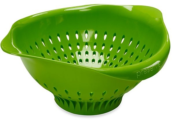 An ordinary green plastic colander.  It is bowl-shaped, with handles and perforations.