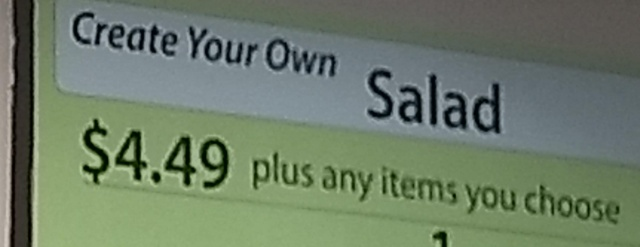 "A sign in a restaurant that says ""Create Your Own Salad"""