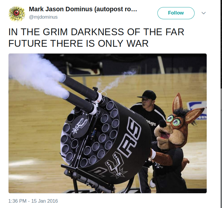 A screen capture of a tweet.  The text says, in all capitals, IN THE GRIM DARKNESS OF THE FAR FUTURE THERE IS ONLY WAR.  Below is a picture of a strange creature with crazed, staring eyes, firing a large and unfamiliar weapon.  On closer examination, this is seen to be the mascot of the San Antonio Spurs basketball team, who is a giant bunny rabbit, operating a device for shooting promotional T-shirts into the stands.